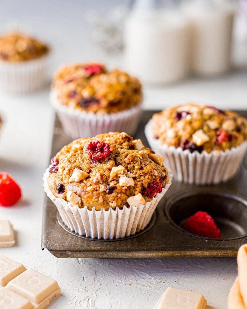 close up of vegan banana bread muffins with raspberry and white chocolate