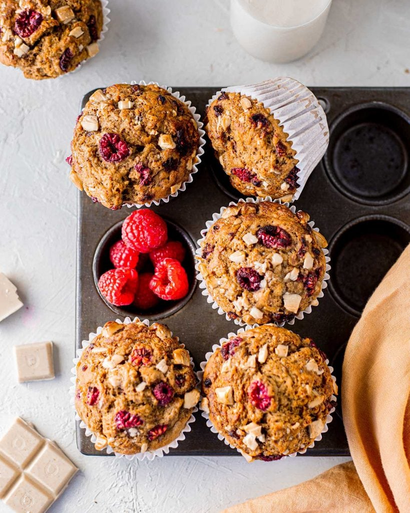 vegan banana bread muffins with raspberries and white chocolate in tray