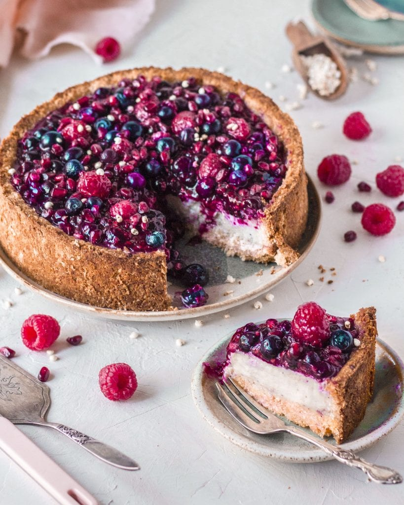 Baked vegan cheesecake with slice coming out