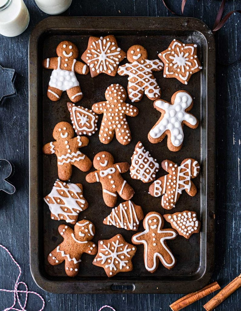 Decorated refined sugar free gingerbread cookies on a baking tray